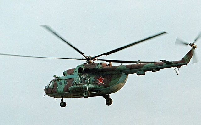 Illustrative: In this Sept. 18, 2002 file photo, an Mi-8 helicopter flies over the Chechen regional capital Grozny, Russia. (AP Photo/Musa Sadulayev, File)