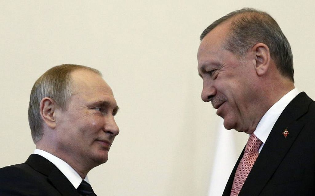 Russian President Vladimir Putin (left), welcomes Turkish President Recep Tayyip Erdogan in the Konstantin palace outside St. Petersburg, Russia, on August 9, 2016. (AP/Alexander Zemlianichenko)