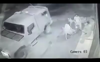 Security camera footage that appears to show soldiers in a military jeep throwing a smoke grenade at Palestinian men sitting outside a store in Kafr Laqif in the northern West Bank on August 15, 2016. (Screen capture: Ramallah News)