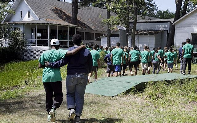 In this Aug. 4, 2016 photo, teens walk together to lunch at the Seeds of Peace camp in Otisfield, Maine. (AP Photo/Elise Amendola)