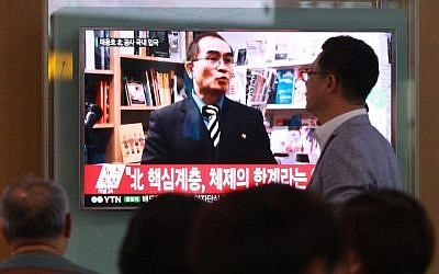 In this Wednesday, Aug. 17, 2016 file photo, people watch a TV news program showing a file image of Thae Yong Ho, a minister at the North Korean Embassy in London, at Seoul Railway Station in Seoul, South Korea. (AP Photo/Ahn Young-joon. File)
