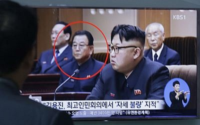 A man watches a TV screen showing Kim Yong Jin, second from left, a vice premier on education affairs in North Korea's cabinet, and North Korean leader Kim Jong Un, second from right, Wednesday, Aug. 31, 2016. (AP Photo/Ahn Young-joon)