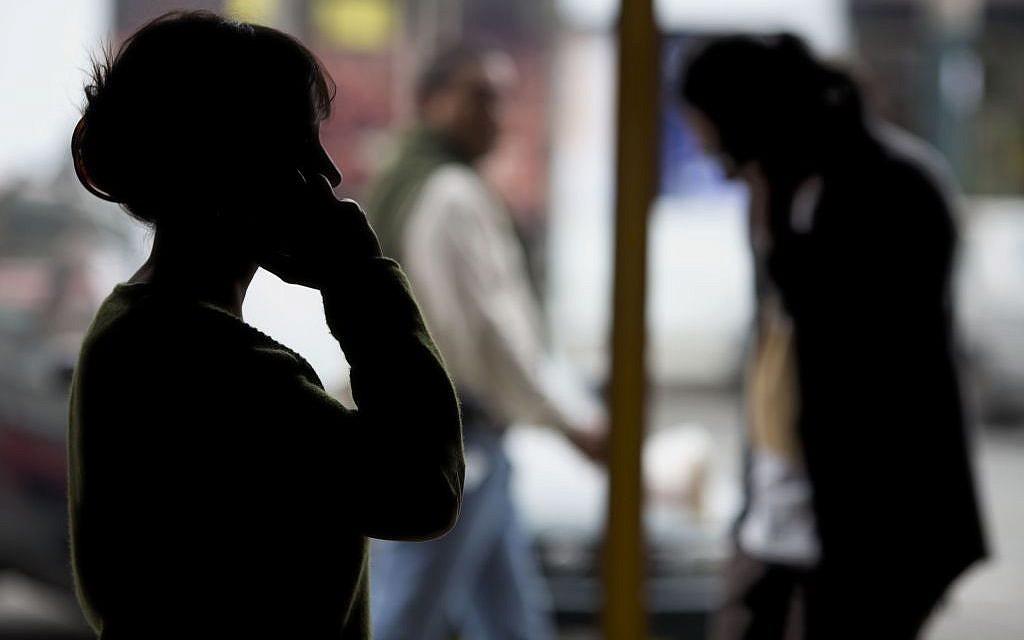 Pedestrians talk on their cellphones in Lima, Peru, on Monday, Aug. 1, 2016.  (AP Photo/Martin Mejia)