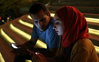 Syrian opposition activists Bahr Abdul Razzak and his wife Noura Al-Ameer in Istanbul, August 1, 2016. (AP Photo/Petros Karadjias)