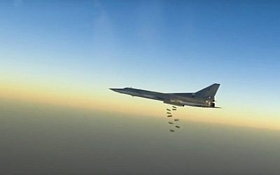 In this frame grab from video provided by the Russian Defense Ministry Press Service, Russian long range bomber Tu-22M3 flies during a strike above an undisclosed location in Syria on Sunday, Aug. 14, 2015. (Russian Defense Ministry press service photo via AP)