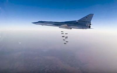 A Russian long range bomber Tu-22M3 flies during a strike above an undisclosed location in Syria on Sunday, Aug. 14, 2015. (Russian Defense Ministry press service photo via AP)