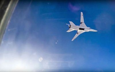 In this frame grab from video provided by the Russian Defense Ministry press service, a Russian long range  Tu-22M3 bomber flies during an air strike over the Aleppo region of Syria on Tuesday, Aug. 16, 2016. (Russian Defense Ministry Press Service photo via AP)