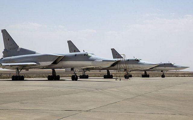 A Russian Tu-22M3 bomber stands on the tarmac at an air base near Hamedan, Iran, Monday, August 15, 2016. (WarfareWW Photo via AP)