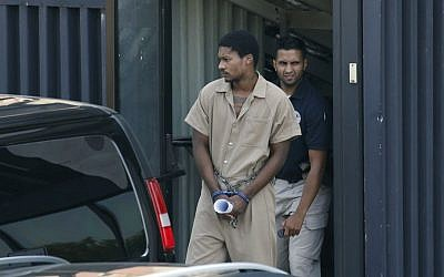 Emanuel Lutchman, who pleaded guilty to conspiracy to support the Islamic State, is transported out of a federal building in Rochester, New York, on August 11, 2016. (Carlos Ortiz/Democrat & Chronicle via AP)