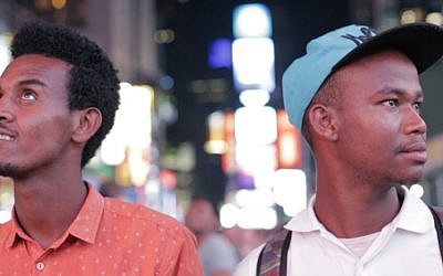 Gezahegn Dereve (left) and Demoz Deboch check out Times Square, NYC on August 6, 2016, on their five week speaking tour through the US to raise awareness about Jews in Ethiopia waiting to move to Israel. (courtesy Ryan Porush)