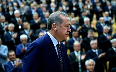Turkey's President Recep Tayyip Erdogan arrives at a conference of the heads of chambers of commerce in Ankara, Turkey, on Thursday, Aug. 4, 2016. (Kayhan Ozer/Presidential Press Service, Pool Photo via AP)