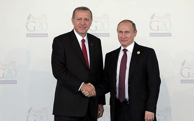 Turkish President Recep Tayyip Erdogan, left, welcomes Russian President Vladimir Putin, at the G-20 summit in Antalya, Turkey, Nov. 15, 2015. (AP Photo/Lefteris Pitarakis, file)