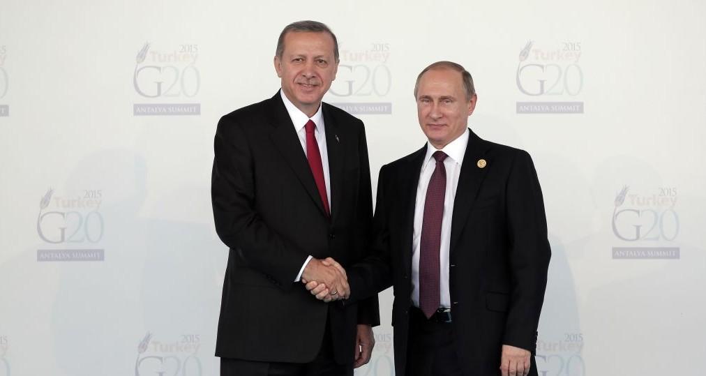 Turkish President Recep Tayyip Erdogan, left, welcomes Russian President Vladimir Putin, at the G-20 summit in Antalya, Turkey, Nov. 15, 2015. (AP Photo/Lefteris Pitarakis, file)