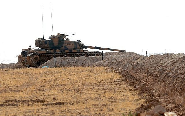 A Turkish tank stationed near the Syrian border, in Karkamis, Turkey, August 29, 2016. (Ismail Coskun/IHA via AP)