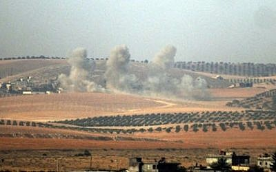 Smokes billows on the Syrian side of the Turkish-Syrian border as Turkey's military and US-backed coalition forces launched an operation to clear a Syrian border town from Islamic State, August 24, 2016. Photo DHA via AP