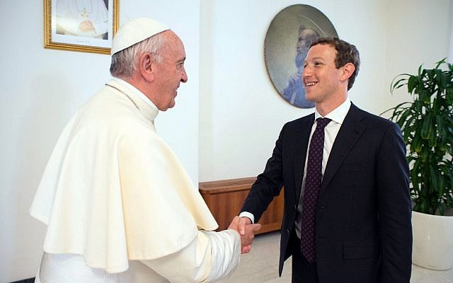 Pope Francis meets Facebook founder and CEO Mark Zuckerberg, at the Santa Marta residence, the guest house in Vatican City where the pope lives, August 29, 2016. (L'Osservatore Romano/Pool/AP)