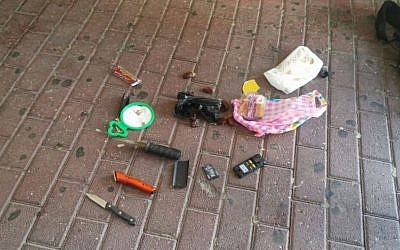 Two knives and a cellphone discovered in the backpack of Ali Abu Hassan, a Palestinian man who has been accused of attempting to bomb the Jerusalem light rail on July 17, 2016. (Israel Police)