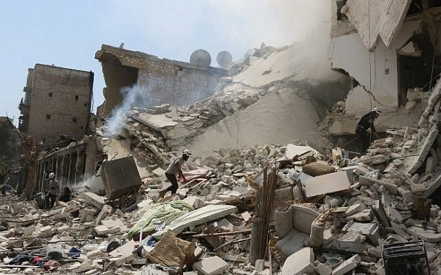Syrian rescue workers search for victims through the rubble of a building destroyed during a reported barrel bomb attack in a rebel-held neighborhood in eastern Aleppo on August 27, 2016. (AFP PHOTO / THAER MOHAMMED)