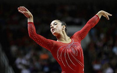 Aly Raisman competes in the floor exercise during Day 2 of the 2016 US Women's Gymnastics Olympic Trials at SAP Center on July 10, 2016 in San Jose, California. (Photo by Ezra Shaw/Getty Images via JTA)