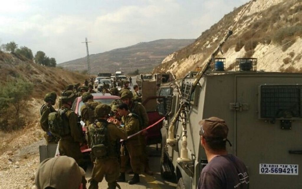 IDF troops attend the scene of a stabbing in the West Bank on August 24, 2016, in which a soldier was lightly hurt. (photo credit: Hatzalah Yehuda & Shomron)