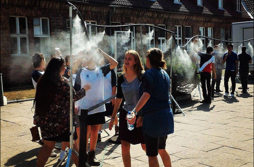 Mist showers outside the Auschwitz memorial museum, installed in 2015 to cool visitors, led to charges of insensitivity. (Facebook)