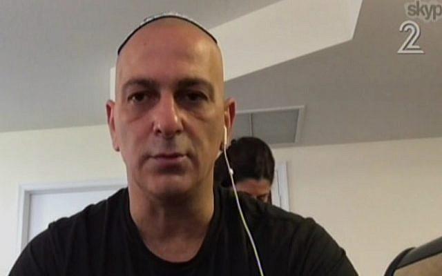 Ofir Ben-Eliezer, the son of deceased former defense minister Binyamin Ben-Eliezer speaks to Channel 2 via Skype on August 30, 2016. (screen capture: Channel 2)