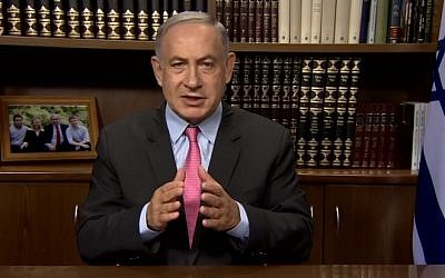 Prime Minister Benjamin Netanyahu speaks in a video published on Facebook on August 11, 2016, in which he slams Hamas for taking aid money to 'build a war machine to murder Jews' (screen capture: Facebook)