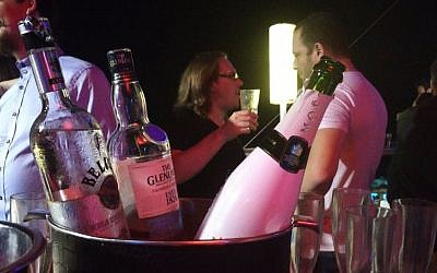 Free drinks at a party held for binary options executives in the Clara club, Tel Aviv, August 12, 2016. (Raoul Wootliff/Times of Israel)