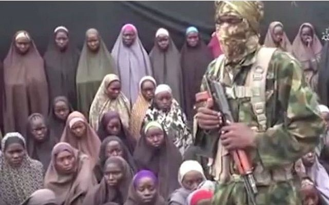 An image taken from a video released on August 14, 2014 by the Nigerian jihadist group Boko Haram purportedly shows dozens of girls kidnapped by the group in 2014. (screen capture: YouTube)