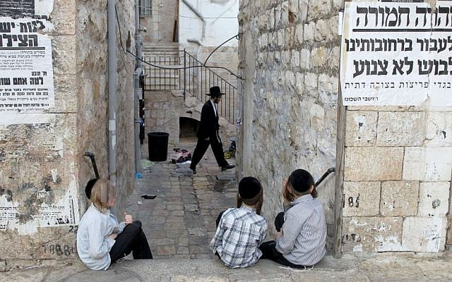 Illustrative: Young ultra-Orthodox Jewish boys sit in the streets in the Mea Shearim neighborhood in Jerusalem on September 16, 2010. (Nati Shohat / Flash90)