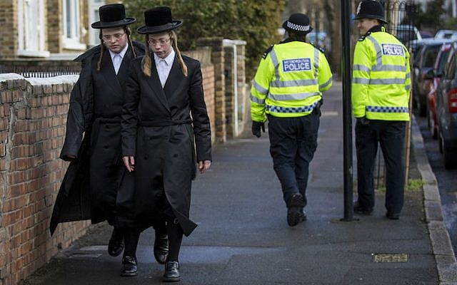 Illustrative: Haredi Orthodox men walking along the street in the Stamford Hill area of London, Jan. 17, 2015. (Rob Stothard/Getty Images via JTA)