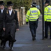 Illustrative: ultra-Orthodox men walking along the street in the Stamford Hill area of London, Jan. 17, 2015. (Rob Stothard/Getty Images via JTA)