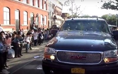 Hasidic children in Kiryas Yoel throw eggs at a mock Netanyahu convoy during an anti-Israel protest in August 2016. (Screenshot/Yeshiva World News)