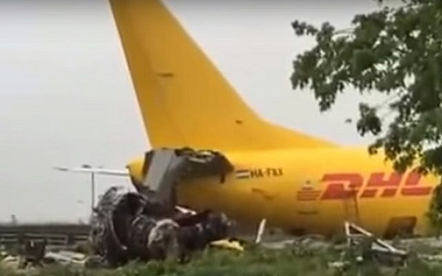 A DHL plane lands up on a highway after bursting through a perimeter fence at Orio al Serio airport in Bergamo, Italy, on August 5, 2016. (screen capture: YouTube)