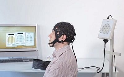 A person wearing an EEG cap (screen capture: YouTube)