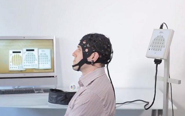 A person wearing an EEG cap (screen capture: YouTube)