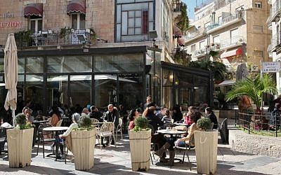Israelis enjoy the sun as they sit outside at Cafe Rimon in downtown Jerusalem on January 14, 2013. (Nati Shohat/Flash90)