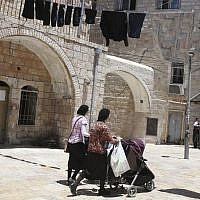 Illustrative: Ultra-Orthodox Jewish women push their baby strollers as they walk in the ultra-Orthodox Mea Shearim neighborhood in Jerusalem, on July 4, 2013. (Nati Shohat/Flash90)
