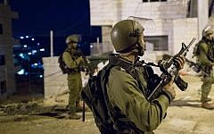 Illustrative: IDF soldiers during an arrest raid in the Deheishe refugee camp, near the West Bank city of Bethlehem, on December 8, 2015. (Nati Shohat/Flash90)
