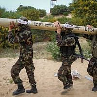 Palestinian militants show a home-made rocket during an anti-Israel joint drill by National Resistance Brigades and Abdel Qader al Husseini Brigades in Khan Younis in the southern Gaza Strip, on March 25, 2016.  (Abed Rahim Khatib/ Flash90.)