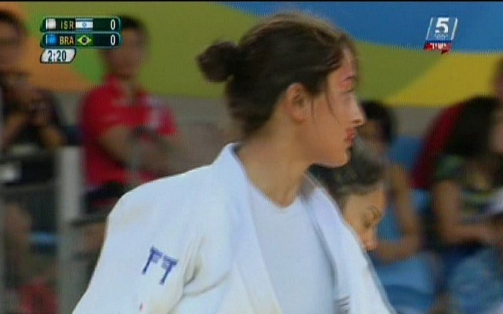 Israeli judoka Yarden Gerbi bleeds from the mouth during the quarterfinal match against Brazil's Mariana Silva in the Olympic women's judo under-63 kilograms competition in Rio de Janeiro, August 9, 2016. (screen shot Channel 55)