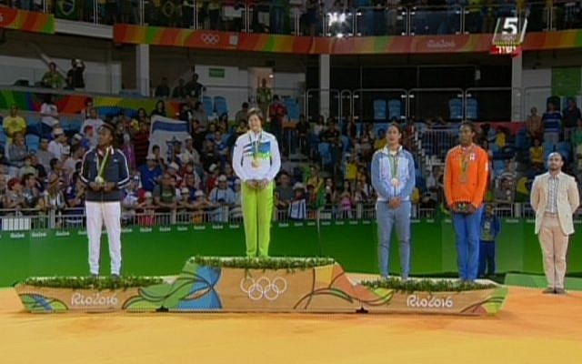 Israeli judoka Yarden Gerbi (2nd right) stands with the other medal winners for the women's under-63kg category during the awards ceremony at the Rio Games on August 9, 2016. Gerbi won bronze,  bringing Israel its first Olympic trophy in eight years (screen capture: Channel 55)