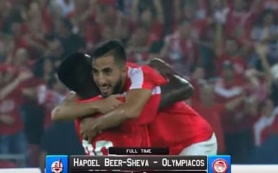 Players from Israel's Hapoel Beersheba FC celebrate the victory against Greek team Olympiacos FC on August 3, 2016 at the Turner Stadium in Beersheba. (screen capture:YouTube)