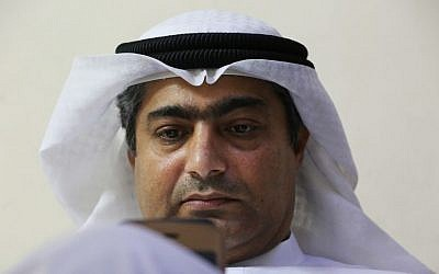Human rights activist Ahmed Mansoor uses his iPhone in Ajman, United Arab Emirates, on Thursday, Aug. 25, 2016. (AP/Jon Gambrell)