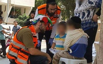 Medic Daniel Klughaupt dons his clown costume when treating an Israeli boy who was hit by a minibus in central Israel, on Thursday August 11 2016. (Courtesy United Hatzalah)