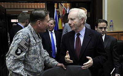 File: Then-senator Joe Lieberman, right, talking to Gen. David Petraeus at the International Security Assistance Force Headquarters in Afghanistan during a congressional delegation tour, Nov. 10, 2010. (Joshua Treadwell)