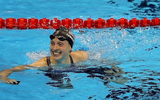 Katie Ledecky celebrating winning gold and setting a new world record in the Women's 400-meter freestyle final on day two of the Rio 2016 Olympic Games at the Olympic Aquatics Stadium, Aug. 7, 2016. (Al Bello/Getty Images via JTA)