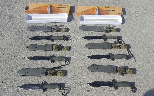 A smuggled shipment of commando knives intercepted by Israeli officials at the Kerem Shalom Border Crossing between Israel and Gaza on August 9, 2016 (Defense Ministry Crossing Authority)