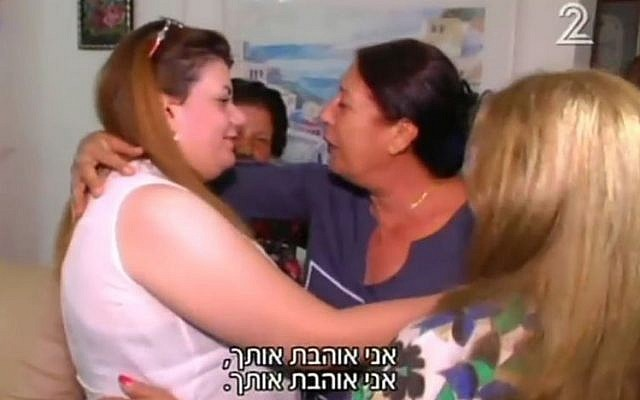 The Jewish Kurdish woman who fled Iraq for Israel after claiming her Muslim husband threatened to sell her to the Islamic State speaks is reunited with her Israeli relatives in August 2016. (screen capture: Channel 2)