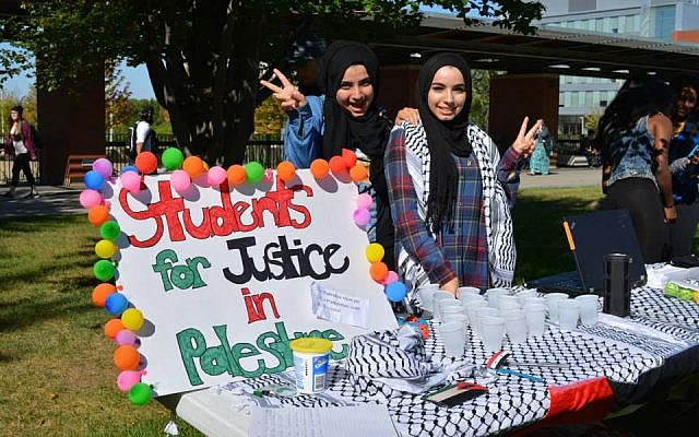 At UOIT outside Toronto, Students for Justice in Palestine activists staff their information table, 2016 (UOIT's SJP chapter Facebook page)